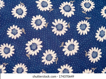 A fabric flowers as a background image.