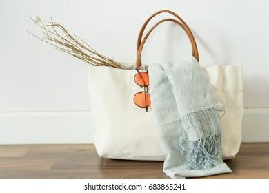 fabric handbag with blue scarf