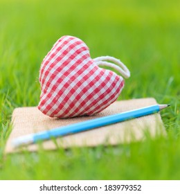 Fabric heart on diary in the park