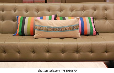 Fabric pillows on leather sofa