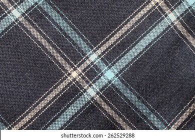 Fabric plaid texture. Cloth diagonal background.