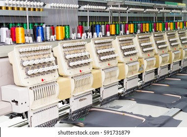 Fabric production line embroidery with industry machinery.