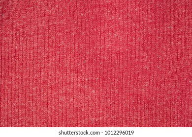 fabric in red color, closeup on stitch
