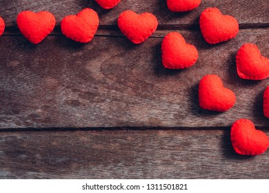 Fabric red heart on wooden background, valentine day concept