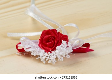 Fabric red rose with white decoration on the table