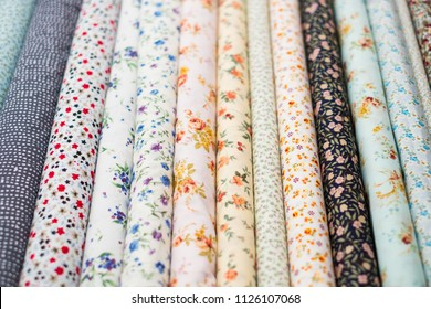 fabric rolls with floral pattern on textile market -