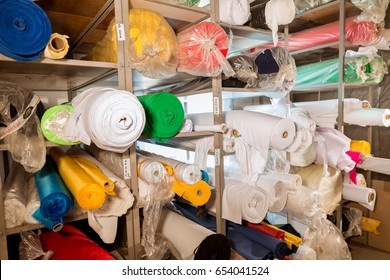 Fabric rolls on shelf for industry