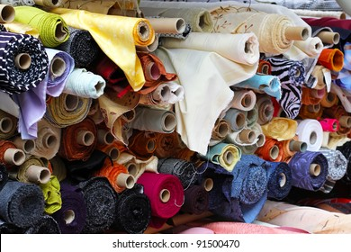 Fabric rolls in shelf for fashion industry
