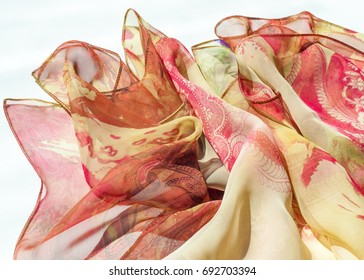 Fabric silk texture, color, abstraction. a fine, strong, soft, lustrous fiber produced by silkworms in making cocoons and collected to make thread and fabric.