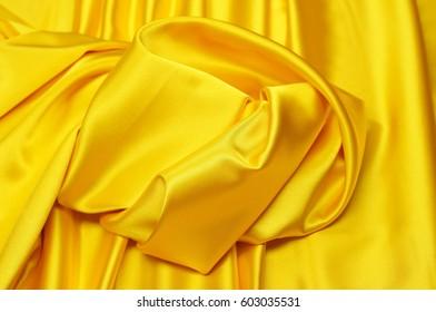 Fabric silk. yellow. Brilliant.  Gloss Gloss