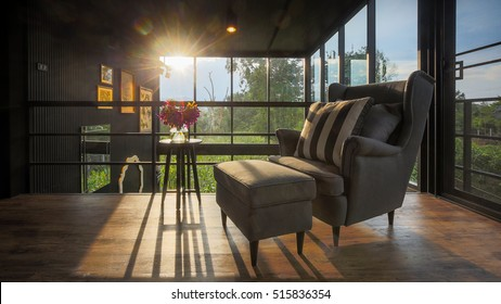 Fabric sofa on wooden floor balcony with glass room view.