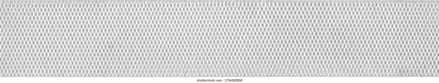 Fabric strap texture band elastic. Wide white elastic. Factory repeating stretch macro texture.Texture Knitted Fabric.Belt sling.