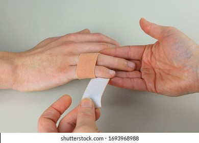 Fabric Strapping Tape Being Used To Support A Dislocated Finger.