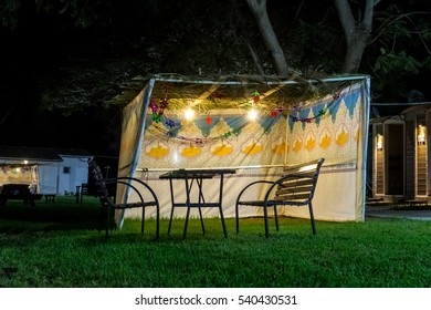 Fabric sukkah decorated with printed pattern and hebrew text of blessing: Grant peace everywhere goodness and blessing, Grace, loving kindness and mercy to us and unto all Israel, Your people. Night