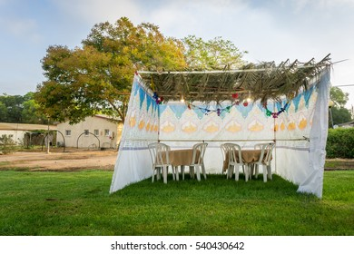 Fabric sukkah decorated with printed pattern and hebrew text of blessing: Grant peace everywhere goodness and blessing, Grace, lovingkindness and mercy to us and unto all Israel, Your people.
