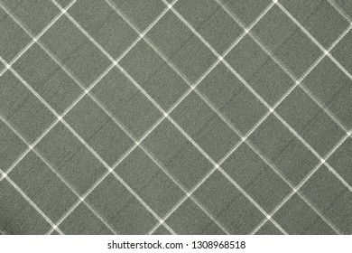 fabric or textile material with a checkered pattern closeup for a fashionable background or for wallpaper of pale green grey color