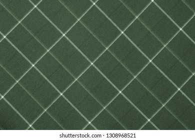 fabric or textile material with a checkered pattern closeup for a fashionable background or for wallpaper of green color