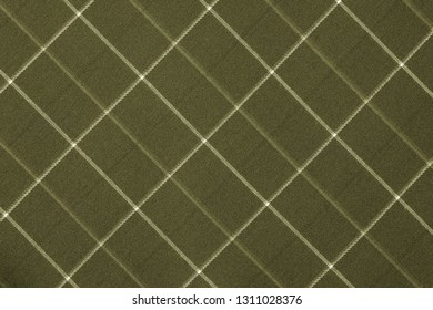 fabric or textile material with a checkered pattern closeup for a fashionable background or for wallpaper of green olive color
