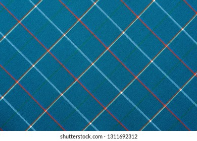 fabric or textile material with a checkered pattern closeup for a fashionable background or for wallpaper of blue color