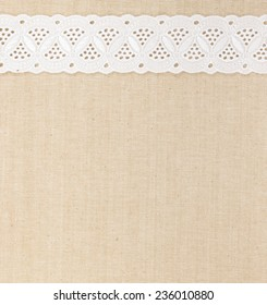 Fabric textile texture with white lace design for background