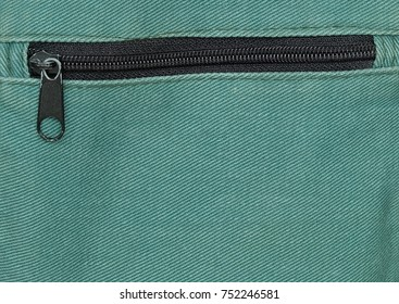 Fabric Texture, Close Up of Metal Zipper on Green Canvas Bag Pattern Background.