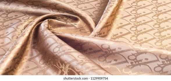 fabric texture red brown, terracotta. Painting on silk cloth. Thai painting pattern of golden brown silk cloth full frame.