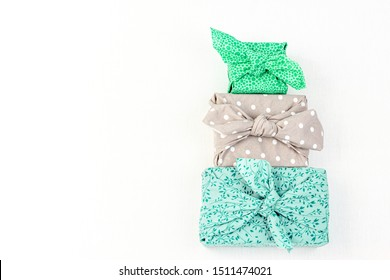 Fabric wrapped gifts, reusable sustainable gift wrapping alternative zero waste concept with copy space
