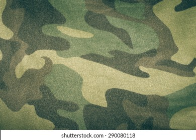 Fabrics with camouflage pattern. Background. Toned.