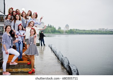 Fabulous bridesmaids posing at the quay next to the lake with their flawless bride. Bachelorette party.