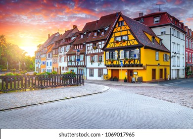 Fabulous colorful traditional french houses on the side of river Lauch in Petite Venise at sunrise, Colmar, France, Europe