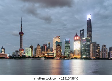 Fabulous evening view of Pudong skyline (Lujiazui) across the Huangpu River in Shanghai, China. Skyscrapers and tower at downtown. Amazing cityscape.