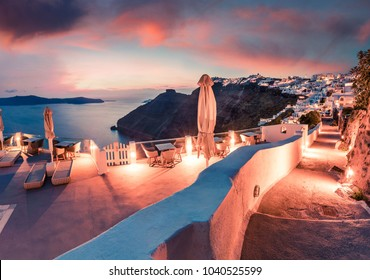 Fabulous evening view of Santorini island. Splendid spring sunset on famous Greek resort Fira, Greece, Europe. Traveling concept background. Artistic style post processed photo.