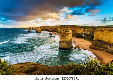 Fabulous morning light on the Pacific coast near Melbourne. Famous Rocks Twelve Apostles in the Ocean Storm Surf. Travel to Australia. The concept of active and phototourism