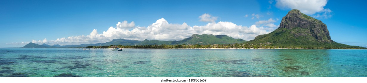 Fabulous panoramic view of the of mountains, colorful clouds and clear ocean/ Mauritius