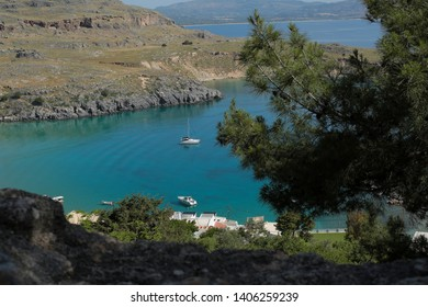 Fabulous place Saint Paul's cove and beach . Lindos Acropolis general fantastic view in Rhodes island in Greece. Great place to go Saint Paul cove and Lindos  necessarily.  Lindos-Rhodes Island/Greece