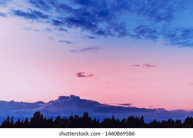 Fabulous spectacular evening landscape with colorful sunset and clouds like mountains