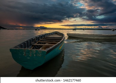 fabulous view of the sunset in Mauritius. Fishing boats on the background of mountains and colorful clouds