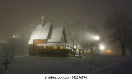 Fabulous winter landscape: heavy fog winter's night. The wooden Nikolskaya Church in Suzdal Kremlin, Russia.
