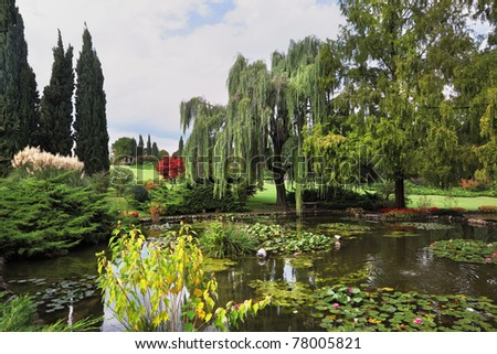 Fabulously beautiful park Ornamental pond and colorful flowers and trees