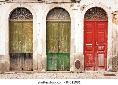 facade of abandoned building with three doors