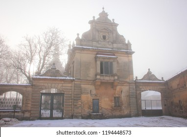 Facade of an abandoned castle in the fog in the Czech Republic