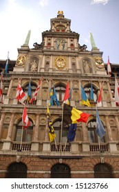 Facade of Antwerp city hall with flags