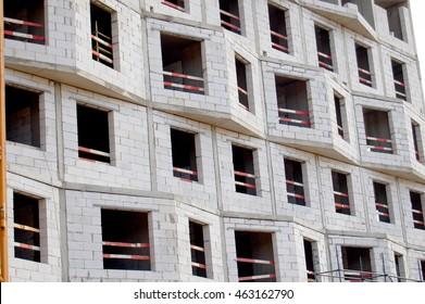 Facade of an apartment house under construction