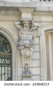 Facade atlante of Real Academia Nacional de Medicina building. Built in 1912 by Luis Maria Cabello Lapiedra. Located in Arrieta Street, Madrid, Spain