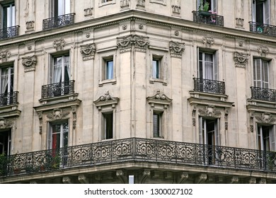facade and balcony of apartment building with ornate 19th century architecture typical of  central Paris