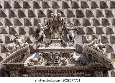 Facade of baroque Gesu Nuovo church, decorative portal, Naples, Italy
