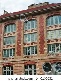 facade of the beaubourg district in paris with soap bubbles