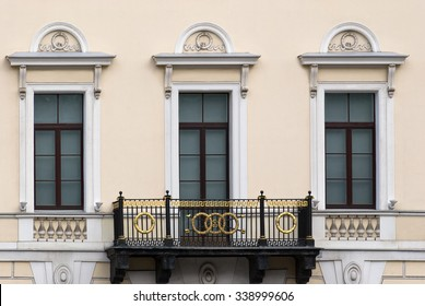 Facade beige building with three rectangular windows and a balcony. From the series window of Saint-Petersburg.