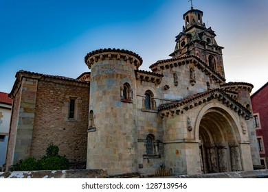 Facade and bell tower of emblematic parish Church of San Miguel. Neo-Romanesque style. Rectangular plan of three naves covered with cannon vault and semicircular apse. Puente Viesgo, Cantabria, Spain