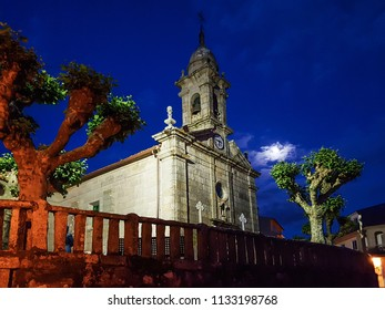 Facade and bell tower of San Xulian church in Arousa Island at night